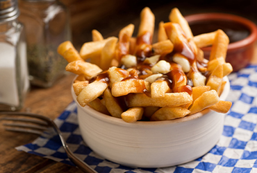 Reggies Hot Grill - Poutine & Drink $5
